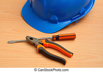 A blue hard hat displayed with a sc