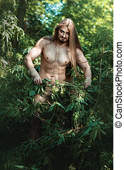 Wild man in the woods - European man living in the woods...