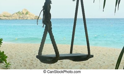 A rope swings on the beach at Similan island, Thailand