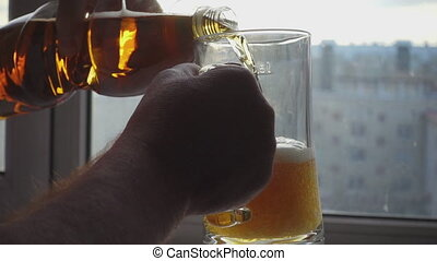 Pouring beer into mug - A man pouring beer into a mug, slow...