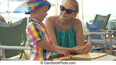 Child learning numerals playing with mom outdoor