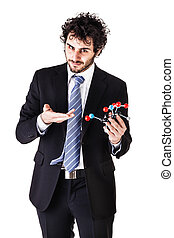businessman holding a tnt molecule - a businessman wearing a...