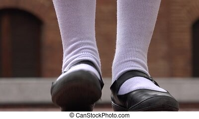 Girl Tapping Her Foot Wearing White Socks