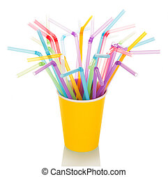 Multi-colored straws for cocktail in disposable cup isolated...