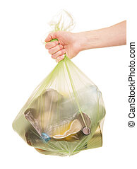 Female hand holding  package with household waste isolated on white.