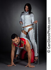 Dance show. Imperious woman and guy in chains - Couple of...