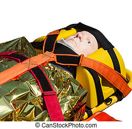 Dummy immobilized on a stretcher for transport or air rescue...