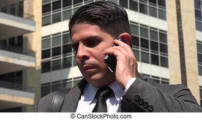 Angry Business Man Talking On Cell Phone