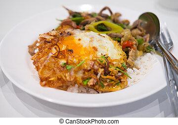 Thai food on steam jasmine rice