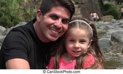Father And Toddler Daughter Smiling