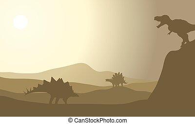 Silhouette of stegosaurus in desert