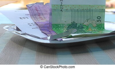 Moroccan money and bill at a cafe - Close up of Moroccan...