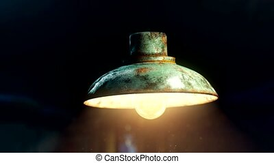 vintage old spot light on black curtain with dust floating...
