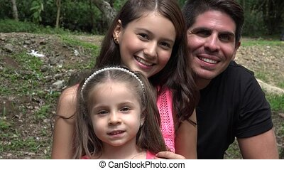Father And Daughters Smiling
