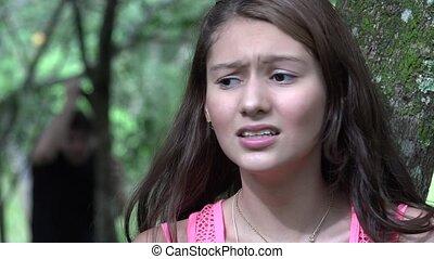 Fearful Teen Girl Hiding From Stalker