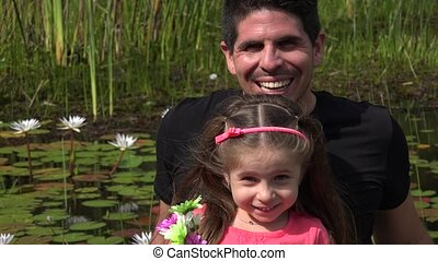 Divorced Father And Daughter At Pond