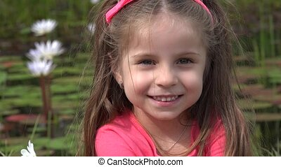 Smiling Toddler Girl Outdoors
