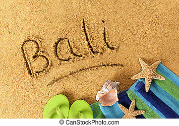 Bali beach writing - The word Bali written on a sandy beach,...