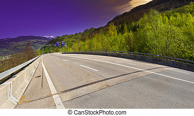 Road in Switzerland - Asphalt Road on the Background of...