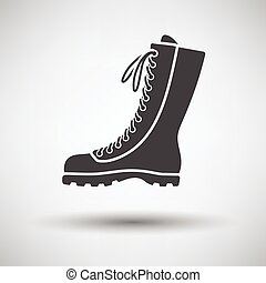 Hiking boot icon on gray background with round shadow Vector...