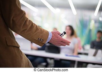 close up of teacher hand while teaching in classroom