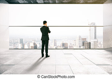 Thoughtful man in interior - Thoughtful businessman in...