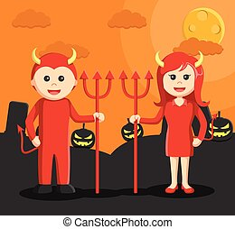 man and woman dressed as a devil