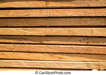 Wood log for construction buildings background, stock photo