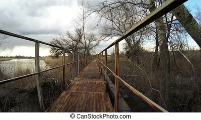 Bridge over river spring - Iron bridge over small river