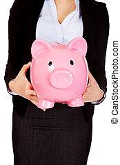 Young business woman holiding piggybank.