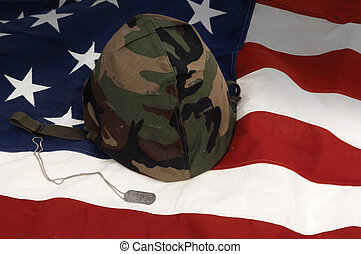 Veteran\'s Day - US Army helmet and dog tag on US flag...