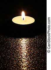 tea light - The light from a candle spread spirit of...