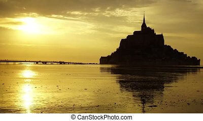 Mont-Saint-Michel at sunset, time lapse.