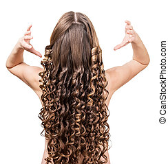 Girl with well-groomed curly hair isolated on white...