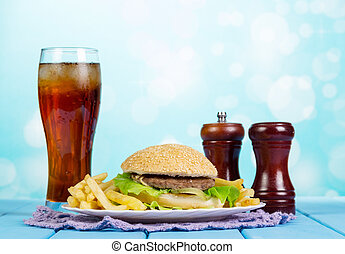 Fast food set hamburger, french fries and glass of cola -...