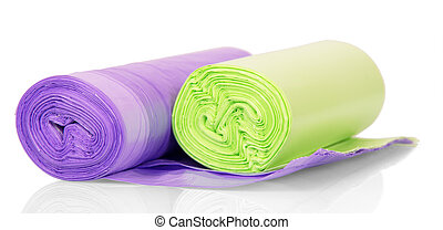Colored garbage bags in rolls isolated on white - Colored...