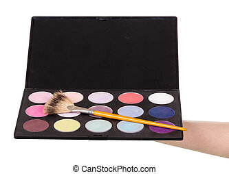 Makeup artists hand holding palette eyeshadow isolated on...