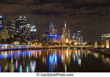 Melbourne city skyline at night with the view of Queens Bridge over the Yarra River