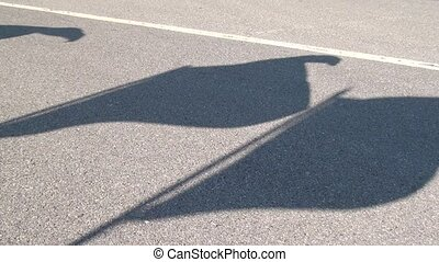 Shadow of Flag in Parking Lot