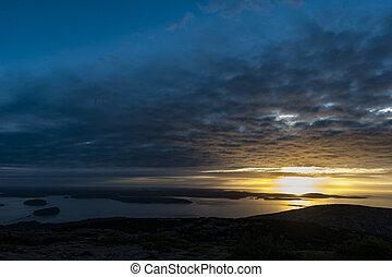 Sunrise at Cadillac Mountain - Rising sun lights underside...