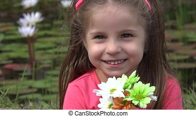 Adorable Toddler Girl With Flowers