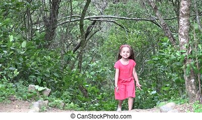 Toddler Girl Walking In Forest
