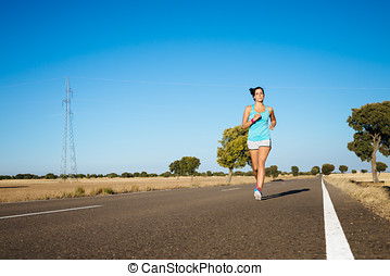 Fitness sporty woman running on road