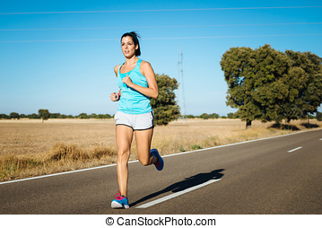 Fit woman running on road