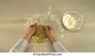Manual dough kneading - Manual dough kneading on a table...