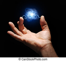 Energy - male hand with electricity arcing between thumb and...