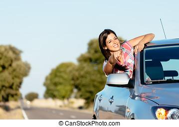 Woman on car roadtrip enjoying freedom