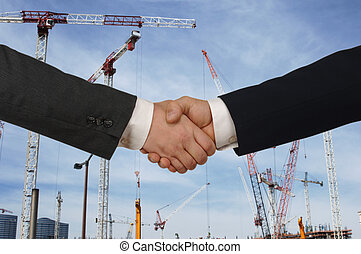 developers - Two men shaking hands in front of a major...
