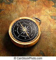 Map & Compass - An old fashoned brass compass on a Treasure...