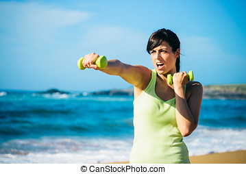 Fitness girl boxing with dumbbells